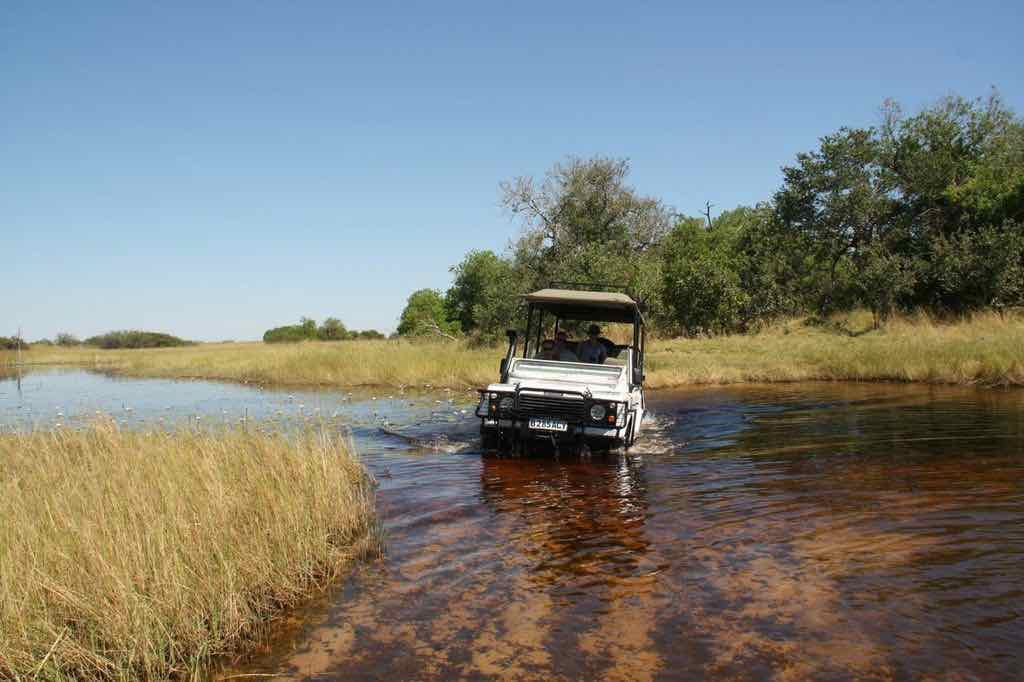Crossing the river in a 4x4 vehicle